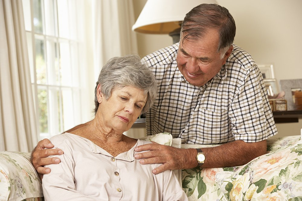 Senior Man Comforting Unhappy Wife At Home